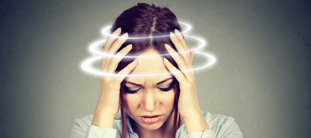 Woman with vertigo dizziness