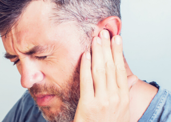 Man with Tinnitus Ear Ringing